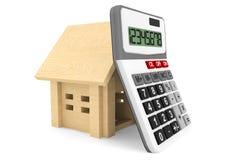 Casa de madera con la calculadora Imagen de archivo