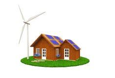 Casa de madera con los paneles solares y una turbina de viento Imagen de archivo