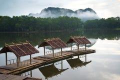 Casa de madera en el agua Fotos de archivo