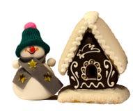casa de pan de jengibre del muñeco de nieve y Fotos de archivo libres de regalías