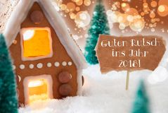 Casa de pan de jengibre, fondo de bronce, Año Nuevo de los medios de Guten Rutsch 2018 Foto de archivo