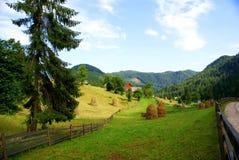 Casa de Piatra, villaggio in Romania Fotografie Stock