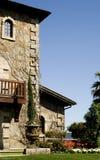Casa de piedra con el jardín Imagen de archivo