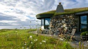 Casa de playa de piedra Imagenes de archivo