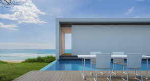 Casa de playa en diseño moderno, chalet de lujo de la piscina de la opinión del mar Fotografía de archivo
