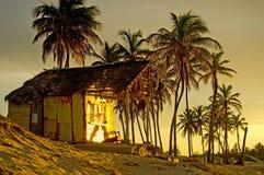 Casa de praia no por do sol Foto de Stock Royalty Free