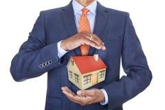 Casa de proteção do homem Imagem de Stock