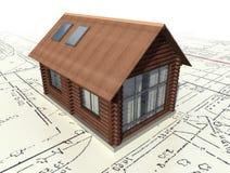 Casa de registro de madera en el plan maestro. Fotos de archivo libres de regalías