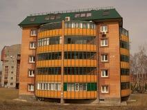 Casa de varios pisos del ladrillo Imagenes de archivo