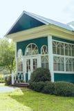 Casa de verão no jardim Imagens de Stock Royalty Free