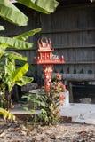 Casa del alcohol en jardín del pueblo Foto de archivo