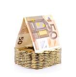 Casa del dinero con la moneda aislada Imagenes de archivo