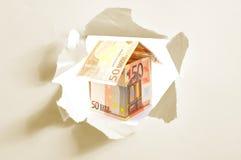 Casa del dinero y agujero euro del papel Fotografía de archivo libre de regalías