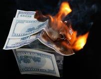 Casa del dólar. fuego Foto de archivo libre de regalías