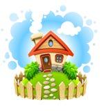 Casa del Fairy-tale en yarda con la cerca de madera Fotos de archivo libres de regalías