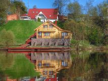 Casa del fiume del villaggio Fotografie Stock