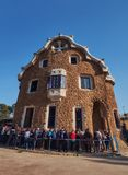 March 2017, Barcelona, Spain - Casa del Guarda in the Park Guell with a queue of tourists with unrecognizable blurred royalty free stock photography