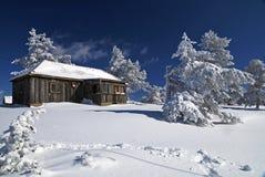 Casa del invierno de la montaña Imagen de archivo libre de regalías