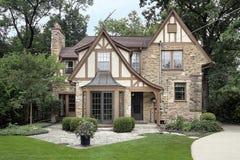 Casa del mattone e patio della pietra Immagine Stock