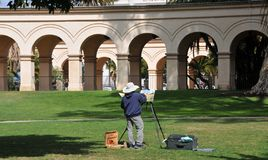 Plein Air Painter at the Casa del Prado Theater at Balboa Park in San Diego California royalty free stock image
