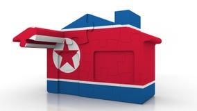 Casa del rompecabezas del edificio que ofrece la bandera de Corea del Norte  Representación conceptual 3D de la construcción core stock de ilustración
