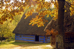 Casa del villaggio in autunno Immagine Stock Libera da Diritti
