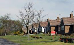 Casa del villaggio da vendere Immagine Stock