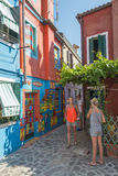 Casa di Bepi, Burano, Italy. Burano, Italy, july 2015. Tourists in front of a multicolored house (Casa di Bepi) with abstract shapes and designs in Burano, one Royalty Free Stock Photo