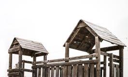 Casa di legno in campo da giuoco Fotografia Stock