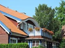 Casa di legno con il balcone Immagini Stock