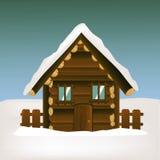 Casa di legno con il paesaggio di inverno Immagini Stock