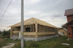 Casa di legno fatta di paglia Fotografie Stock