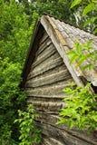 Casa di legno nel legno Immagine Stock