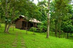 Casa di legno nella foresta Fotografia Stock Libera da Diritti