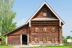 Casa di legno Two-storey di un coltivatore ricco. Immagine Stock Libera da Diritti