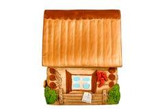 Casa di modello miniatura del paese (porcellino salvadanaio) Fotografia Stock