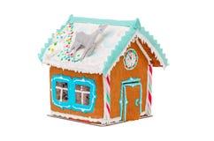 Casa di pan di zenzero di Natale con la renna e la a Immagine Stock Libera da Diritti