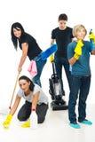 Casa di pulizia di lavoro di squadra della gente Fotografia Stock