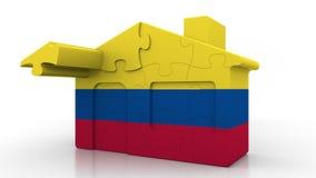 Casa di puzzle della costruzione che caratterizza bandiera della Colombia Emigrazione colombiana, costruzione o mercato immobilia illustrazione vettoriale