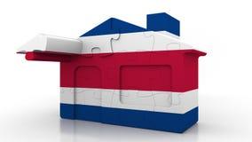 Casa di puzzle della costruzione che caratterizza bandiera di Costa Rica Emigrazione, costruzione o mercato immobiliare di Costa  illustrazione di stock
