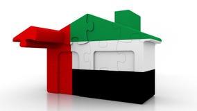 Casa di puzzle della costruzione che caratterizza bandiera degli Emirati Arabi Uniti Emigrazione, costruzione o mercato immobilia illustrazione di stock