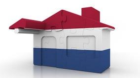 Casa di puzzle della costruzione che caratterizza bandiera dei Paesi Bassi Emigrazione olandese, costruzione o mercato immobiliar illustrazione vettoriale