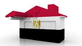 Casa di puzzle della costruzione che caratterizza bandiera dell'Egitto Emigrazione, costruzione o mercato immobiliare egiziana 3D illustrazione vettoriale