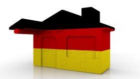 Casa di puzzle della costruzione che caratterizza bandiera della Germania Emigrazione, costruzione o mercato immobiliare tedesca  royalty illustrazione gratis