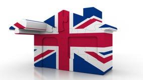 Casa di puzzle della costruzione che caratterizza bandiera della Gran Bretagna Emigrazione, costruzione o mercato immobiliare bri illustrazione di stock