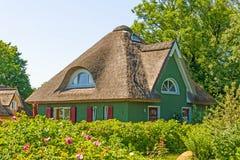casa di vacanza del Ricoprire di paglia-tetto Immagini Stock