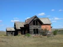Casa dilapidada vieja del ladrillo de Sims Fotos de archivo