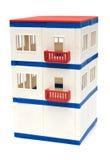 Casa do brinquedo em um fundo branco Fotos de Stock