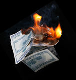 Casa do dólar. fogo Fotos de Stock Royalty Free