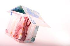 Casa do dinheiro no canto Fotografia de Stock Royalty Free